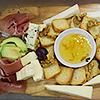 Tábua de queijos e presunto